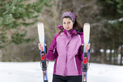 Portrait of  a Young woman  skier on the ski slope Royalty Free Stock Photo