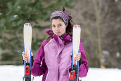 Portrait of  a Young woman  skier on the ski slope Stock Photo