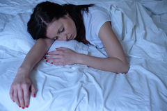 Portrait of young woman sleeping in bed royalty free stock photo