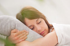 Portrait of a young woman sleeping on the bed Stock Image
