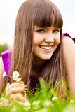 Portrait of young woman with small bouquet Stock Image
