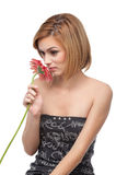 Portrait of a young woman smelling a flower Royalty Free Stock Images