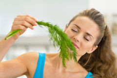 Portrait of young woman smelling fresh dill Stock Images