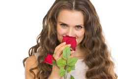 Portrait of young woman smelling red rose Stock Photos