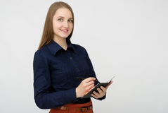 Portrait of young woman. Smiling business woman with folded hands against . Toothy smile, crossed arms Stock Photos