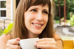 Portrait of young woman smiling in cafe Stock Photography