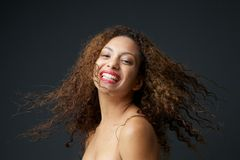 Portrait of a young woman smiling with curly hair Stock Photos