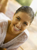 Portrait of a young woman smiling. With damp hair Stock Photo