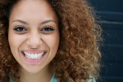 Portrait of a young woman smiling with happy expression on face Royalty Free Stock Image