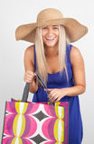 Portrait of a young woman smiling with her shopping bags Royalty Free Stock Images