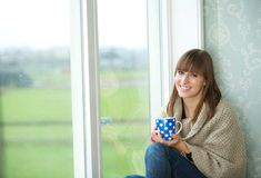 Young Woman Smiling with Tea Cup Stock Photo