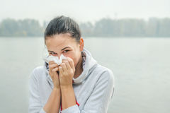 Portrait of a young woman  with snuffle or allergy reaction Royalty Free Stock Images