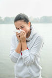 Portrait of a young woman  with snuffle or allergy reaction. Cold Stock Photos