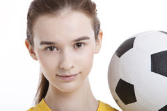 Portrait of young woman with soccer ball against white background Royalty Free Stock Image