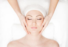 Portrait of a young woman on a spa procedure Stock Photos