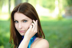 Portrait of young woman speaking on Stock Photo