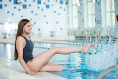 Portrait of a young woman in sport swimming pool Royalty Free Stock Photo