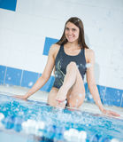 Portrait of a young woman in sport swimming pool Royalty Free Stock Photography