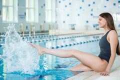 Portrait of a young woman in sport swimming pool Stock Photo