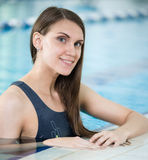 Portrait of a young woman in sport swimming pool Royalty Free Stock Images