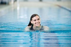 Portrait of a young woman in sport swimming pool Stock Image