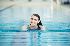 Portrait of a young woman in sport swimming pool Stock Photos