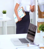 Portrait of a young woman standing with folder Royalty Free Stock Photo