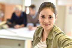 Portrait of young woman standing at office stock image