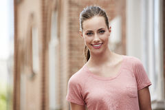 Portrait of young woman standing outdoors, smiling Royalty Free Stock Image