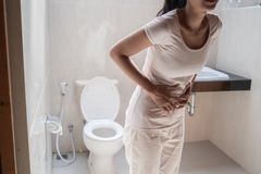 Portrait young woman standing in the toilet stock photography