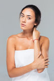 Portrait of a young woman standing in towel Royalty Free Stock Photos