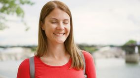 Portrait of young woman standing on waterfront in Paris. Young lonely tourist travelling in Europe stock footage