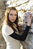 Portrait of young woman on stonewall Royalty Free Stock Images
