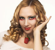 Portrait of young woman with  strawberry. Portrait of pretty blonde with fresh strawberry Royalty Free Stock Image