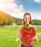 Portrait of young woman with strawberry Stock Photos