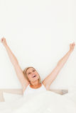 Portrait of a young woman stretching her arms Royalty Free Stock Images