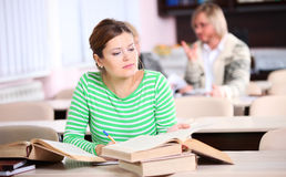 Portrait of young woman studying Royalty Free Stock Photo