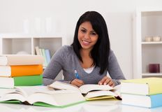 Portrait Of Young Woman Studying Royalty Free Stock Photos