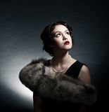 Portrait of the young woman in style of a retro Royalty Free Stock Photos