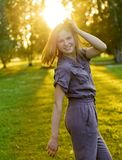Portrait of young woman in stylish overalls Royalty Free Stock Photo