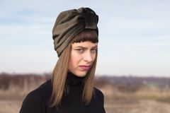 Portrait of young woman with suede turban. Portrait of young woman with turban stock images