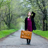 Portrait of young woman with suitcase Royalty Free Stock Images
