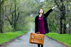 Portrait of young woman with suitcase Stock Image