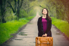 Portrait of young woman with suitcase Stock Photos