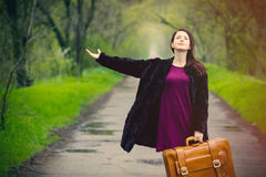Portrait of young woman with suitcase Royalty Free Stock Photo