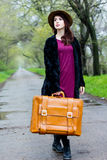 Portrait of young woman with suitcase Royalty Free Stock Photography
