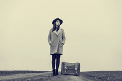 Portrait of young woman with suitcase Royalty Free Stock Image