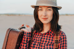Portrait of young woman with suitcase Stock Photography