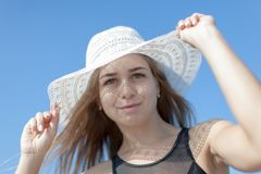 Portrait of young woman in sun hat against sky Royalty Free Stock Photography