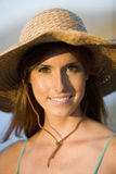 Portrait of young woman in sun hat, close-up Stock Photography
